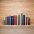 books on floating oak shelf